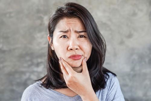 An Asian woman with facial paralysis